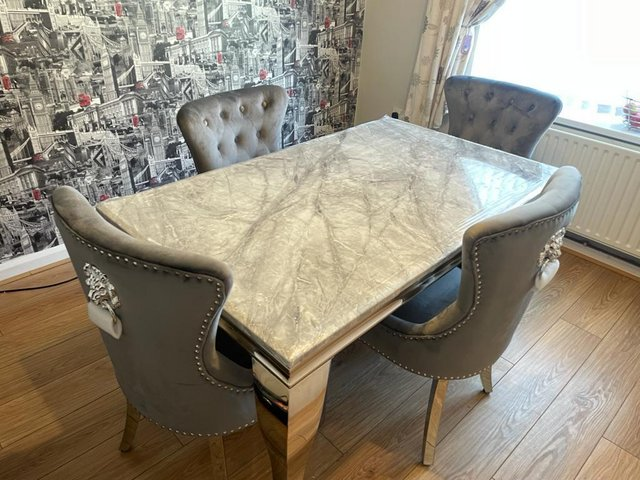 Preview of the first image of Brand new 1.5m grey marble table 4 lion chairs £899.