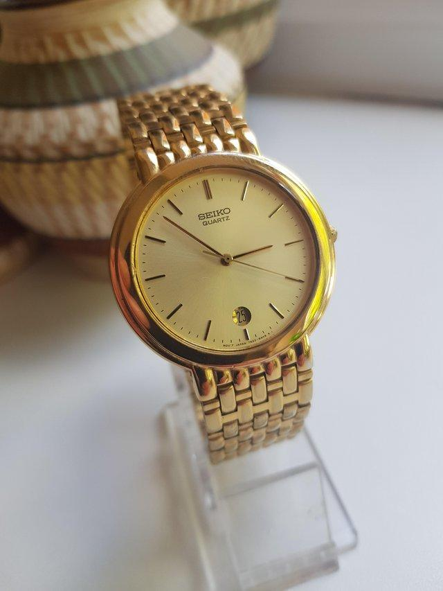 Preview of the first image of Mens seiko quartz watch 7N22-6A00 gold link strap.