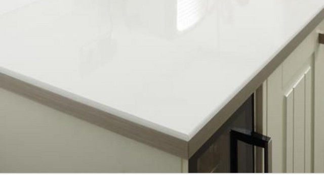 Preview of the first image of Howdens White Glass Effect Worktop & Breakfast Bar.