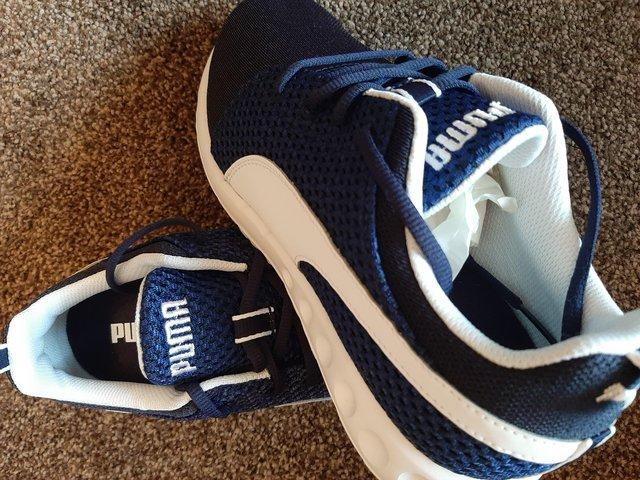 Preview of the first image of Puma trainers.