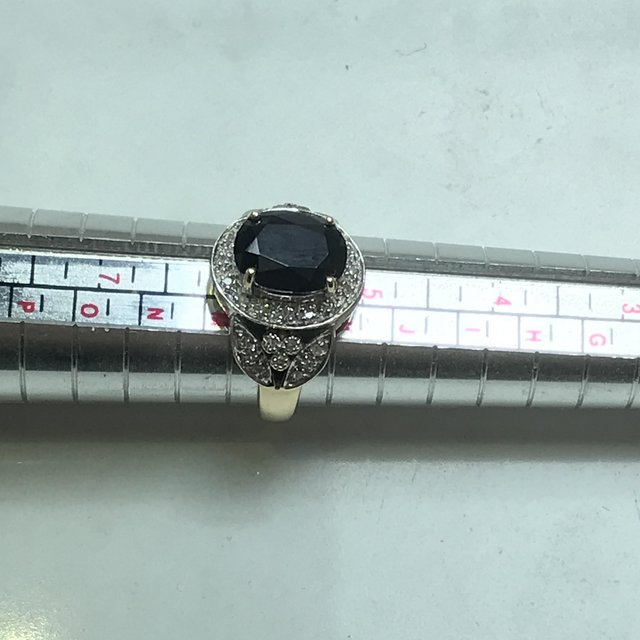 Preview of the first image of Vintage Black sapphire plus pave set diamonds 375 9ct ring.