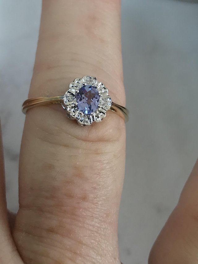 Preview of the first image of Corn flower blue/hint lilac stone diamonds 375 9ct gold ring.
