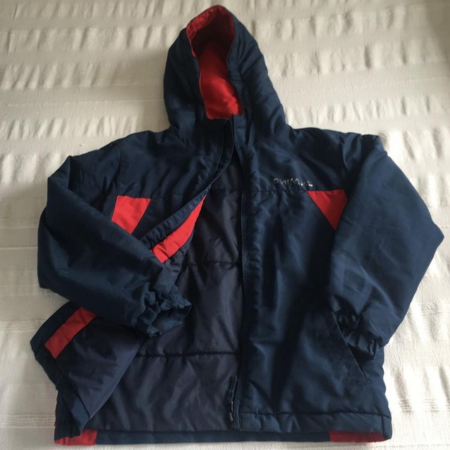 Preview of the first image of Animal brand navy/red padded jacket, hood. 7-8 years..