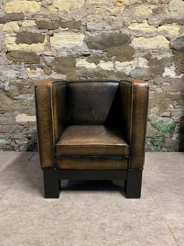 Preview of the first image of Tan Leather RARE Rustic Tub Chair.