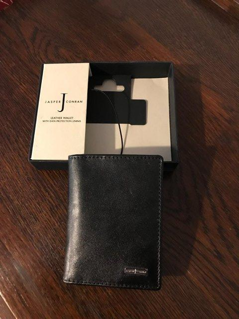 Preview of the first image of Black leather wallet by Jasper Conran; data protection lined.