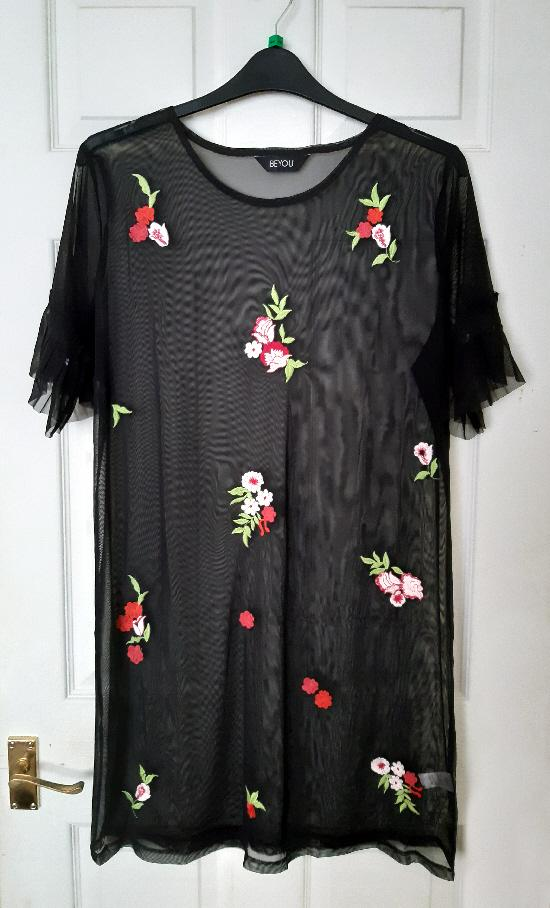 Preview of the first image of Pretty Black Flowered Mesh Top By Beyou - Size 16/18.