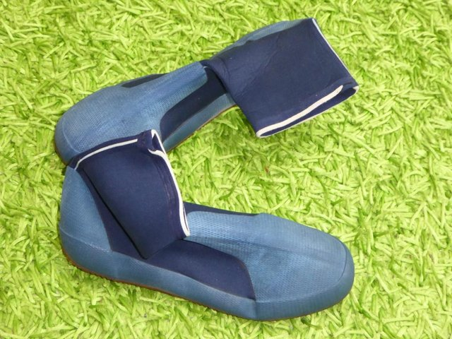 Preview of the first image of Booties made of wetsuit material size 12.