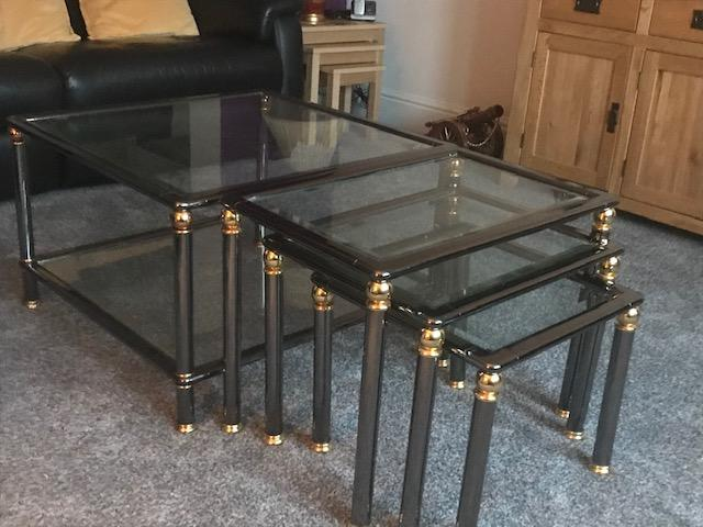 Preview of the first image of Glass top coffee table and Matching Nest of 3 tables.