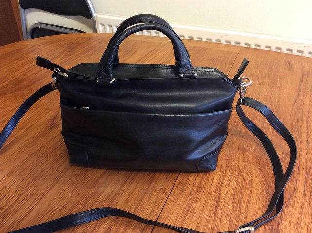 Preview of the first image of Black leather handbag in good condition.
