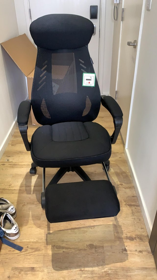 Preview of the first image of Ergonomic Recliner Office Chair with Footrest and Cushioning.