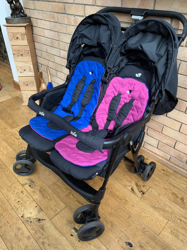 Preview of the first image of Joie Double Pushchair with raincover.