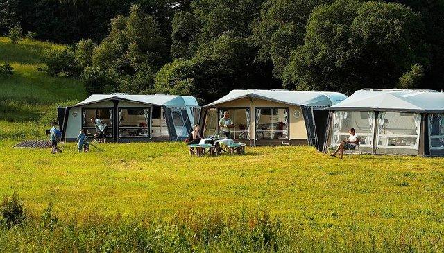 Caravans in field